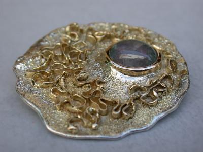 broche zilver met 18karaats geel goud met toermalijn