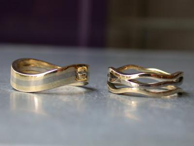 trouwringen bicolor modern opengewerkt 14 kr goud met paladium arnhem