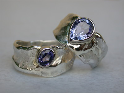 trouwringen met peer saffier zilver met goud
