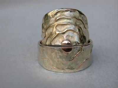 trouwringen zilver met geel en rood goud draad ingesmolten